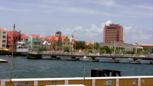 Famous boat bridge on curacao The famous boat bridge in Willemstad on Curacao curaçao stock videos & royalty-free footage