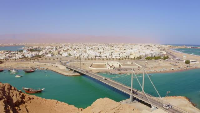 aerial famous bridge khor al batah in sur - oman стоковые видео и кадры b-roll