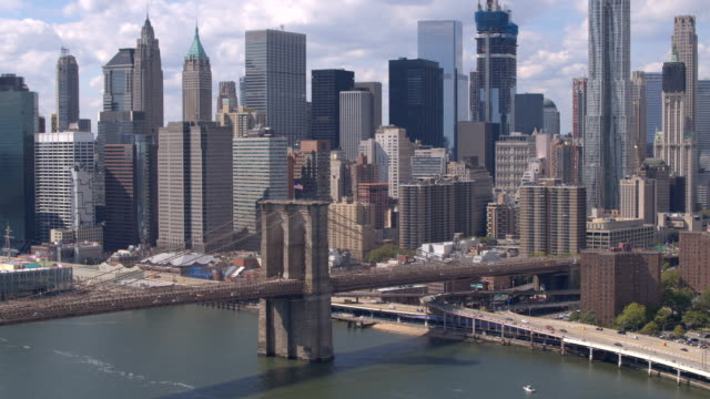 AERIAL: Famous Brooklyn Bridge against Lower Manhattan downtown cityscape video