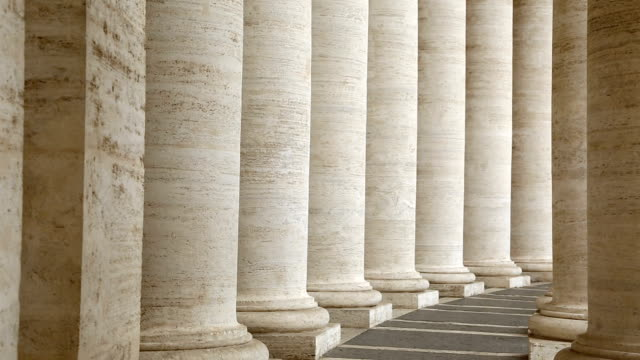 Famous colonnade of St. Peter's Basilica in Vatican Famous colonnade of St. Peter's Basilica in Vatican architectural column stock videos & royalty-free footage