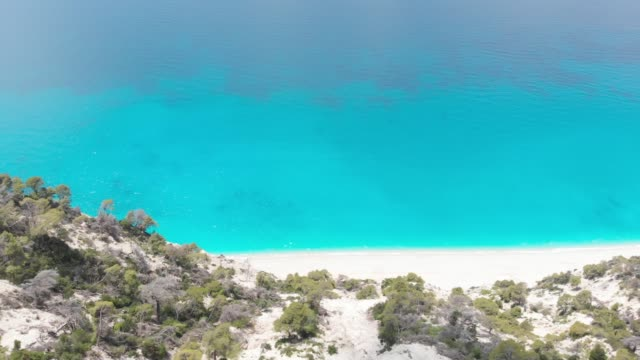 Famous Egremni beach, aerial view of a rocky cliffs and waves Famous Egremni beach, aerial view of a rocky cliffs and waves crashing at the sandy beach, Lefkada Greece 天の川 stock videos & royalty-free footage