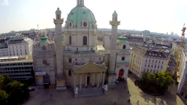 Famous Karlskirche Baroque church in Vienna, Europe city aerial. Beautiful aerial shot above Europe, culture and landscapes, camera pan dolly in the air. Drone flying above European land. Traveling sightseeing, tourist views of Austria. video