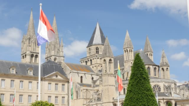 Famous Mens Abbey by the day William the Conqueror legacy against blue sky 4K Famous Mens Abbey by the day William the Conqueror legacy against blue sky 4K 3840X2160 slow tilt UltraHD footage - Abbaye aux Hommes located in city of Caen of France in Normandy 4K 2160p UHD video caen stock videos & royalty-free footage