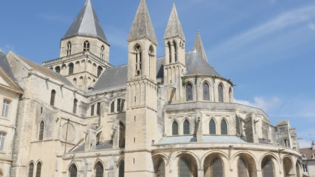 Famous Mens Abbey exterior by the day Normandy France 4K Famous Mens Abbey exterior by the day Normandy France 4K 3840X2160 slow tilt UltraHD footage - French Abbaye aux Hommes located in city of Caen Normandie 4K 2160p UHD video caen stock videos & royalty-free footage