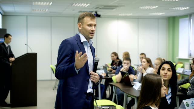 Famous speaker holds business training in the classroom video