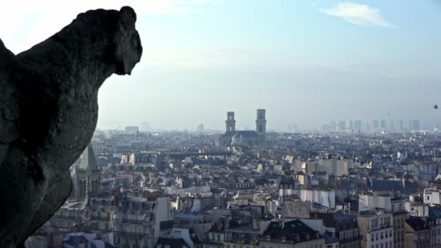4k, famous stone gargoyle statue in notre dame cathedral with city of paris. - gargoyle video stock e b–roll