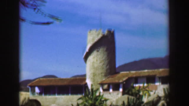 1952: fancy wealthy tropical cliff villa mansion medieval castle tower home. - guerrero video stock e b–roll