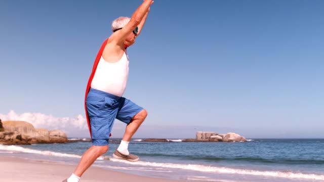 Fancy-dress mature man jumping video