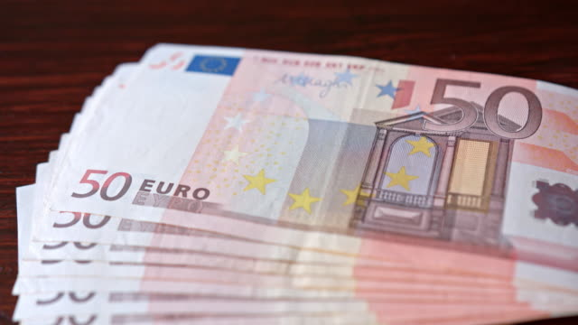 Fanned Pile of Fifty Euro Banknotes on a Table video