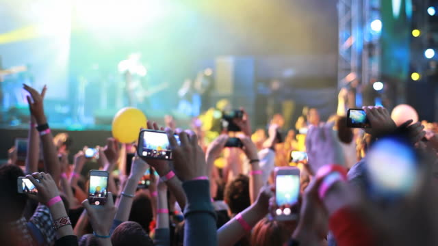 Fans waving their hands and hold phone with digital displays crowd at concert. Fans waving their hands and hold the phone with digital displays the crowd at a rock concert. classical concert stock videos & royalty-free footage