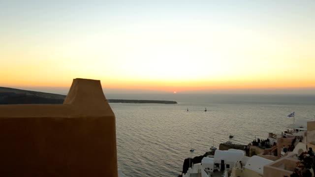 Fantastic sunset seen from Fira town on Santorini island, romantic vacation Fantastic sunset seen from Fira town on Santorini island, romantic vacation aegean islands stock videos & royalty-free footage
