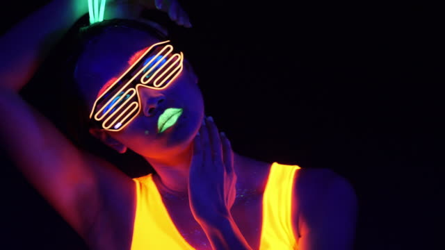 Video Fantastic video of sexy cyber raver woman filmed in fluorescent clothing under UV black light.Sexy girl cyber glow raver women filmed in fluorescent clothing under UV black light,party concept