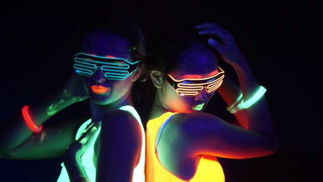 Fantastic video of sexy cyber raver woman filmed in fluorescent clothing under UV black light.Sexy girl cyber glow raver women filmed in fluorescent clothing under UV black light,party concept video