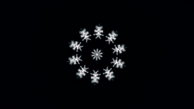 Fantasy kaleidoscopic Christmas background with snowflake in the middle. video