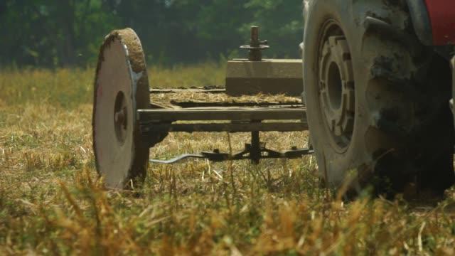 farm machinery on a farm cutting grass for livestock