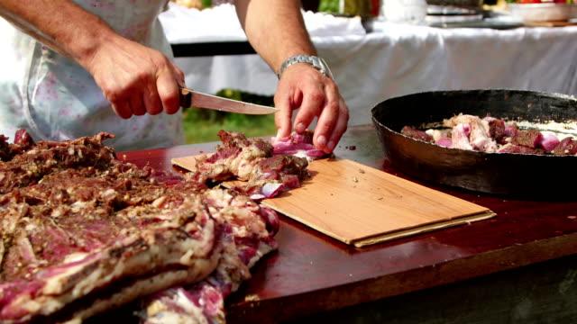 Farmer cutting (pastirma) air-dried spiced lamb meat into small pieces Farmer cutting (pastirma) air-dried spiced lamb meat into small pieces jerky stock videos & royalty-free footage