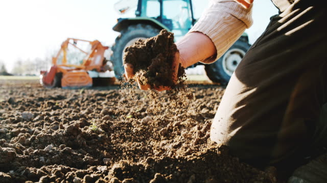 slo mo farmer examining the soil - agricultural machinery stock videos & royalty-free footage