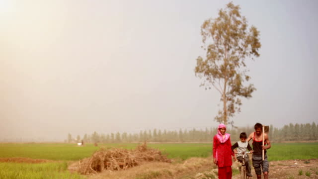 Farmer family portrait with cycle video