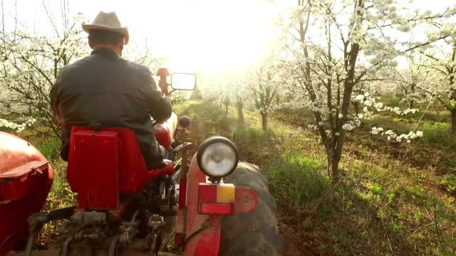 Farmer going through a farm on a  tractor video