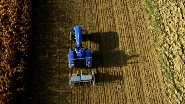 AERIAL Farmer Harrowing A Field video