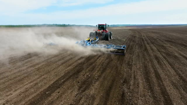 Farmer in tractor preparing land for sowing video