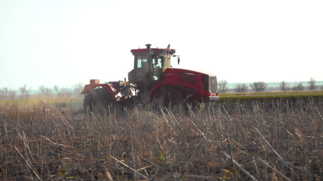 Farmer in tractor Russia agriculture soil ground preparing land with seedbed cultivator as part of pre seeding activities in early spring lifestyle season of agricultural works at farmlands - vídeo