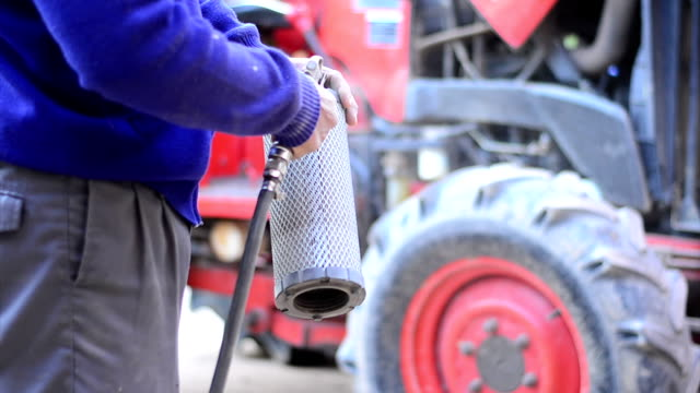 Farmer is putting pushcart engine air filter video