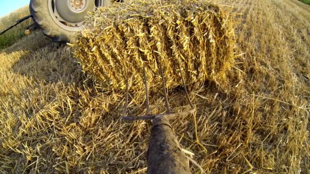 POV Farmer Loading Bale On A Trailer video