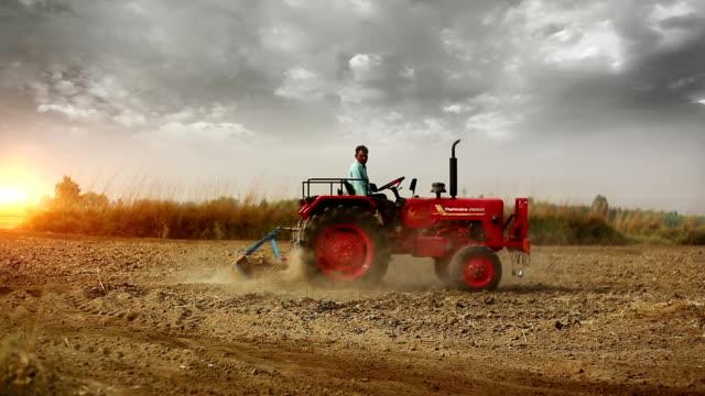 farmer plowing field - trattore video stock e b–roll