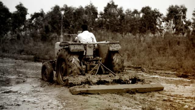 Farmer plowing field video