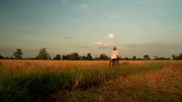 Farmer riding bicycle