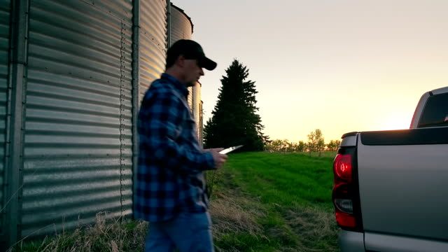 Farmer uses a digital tablet to access the internet video