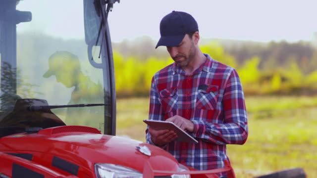 farmer using digital tablet - farmer stock videos and b-roll footage