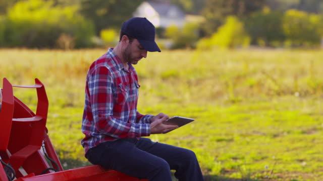 Farmer using digital tablet video
