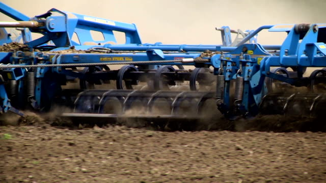 Farmer with tractor seeding video