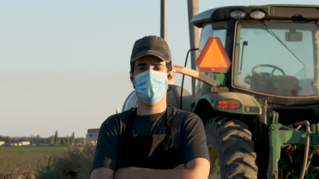 Video Farmer worker wearing a protective face mask due Covid-19 contagion prevention