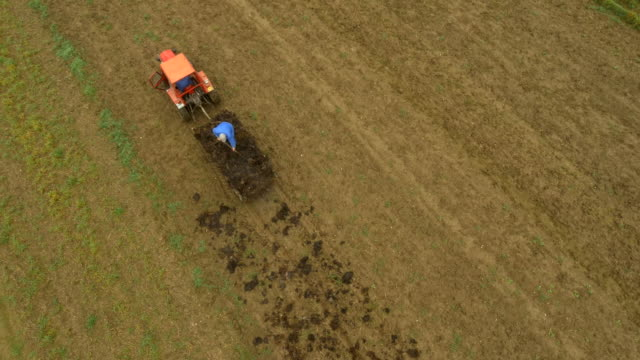 AERIAL Farmer Working On Field In The Morning video