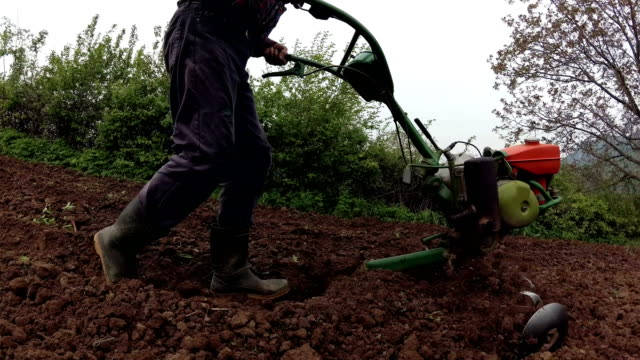 farmer working with roto tiller & cultivator - mika video stock e b–roll