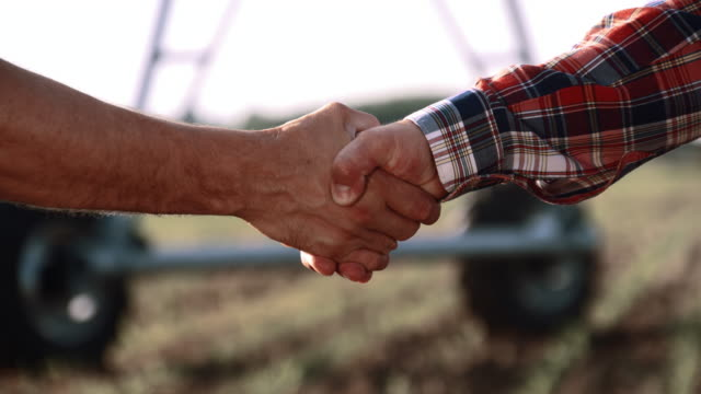 MS Farmers handshaking in the field video