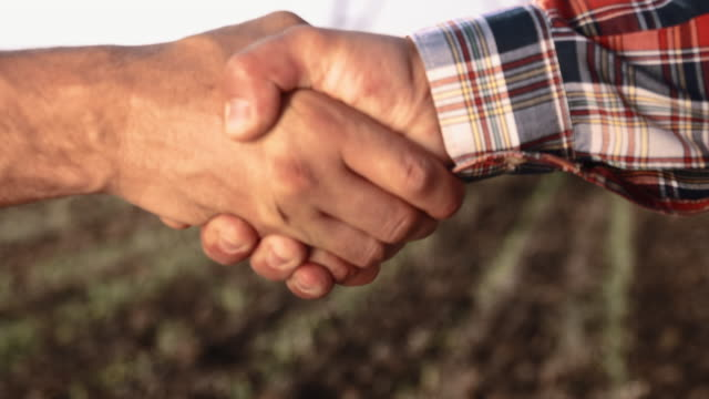 CU Farmers shaking hands in the field video