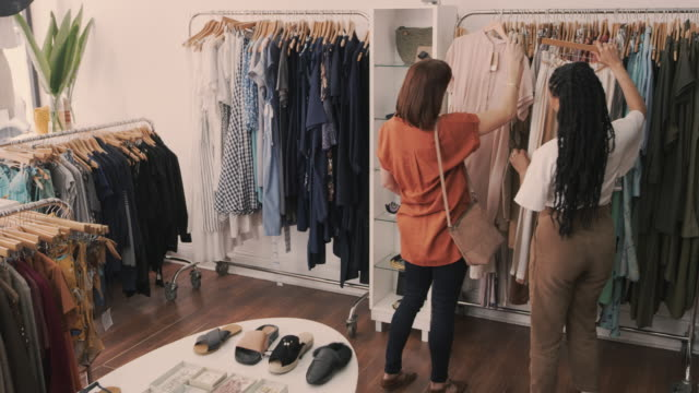 Fashion advice she can trust 4k video footage of a young woman serving a customer in a clothing boutique small business saturday stock videos & royalty-free footage