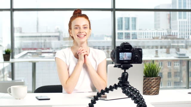 Fashion blogger making a video using a camera with a tripod video