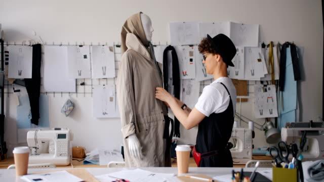 fashion designer dressing mannequin checking handmade gadment working alone - sarta video stock e b–roll