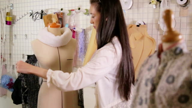 Fashion designer in studio pinning clothes on mannequin front Fashion designer in studio pinning clothes on mannequin front fabric swatch stock videos & royalty-free footage