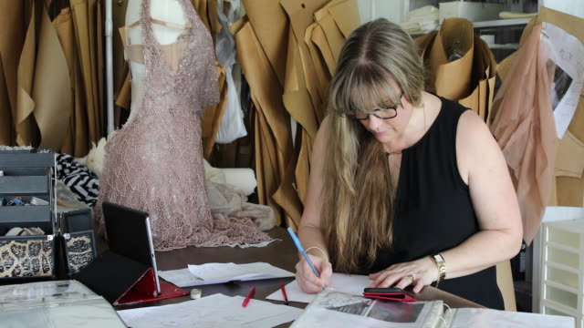 Fashion Designer Sketching Dress Ideas In Home Studio 4k Stock Video Download Video Clip Now Istock