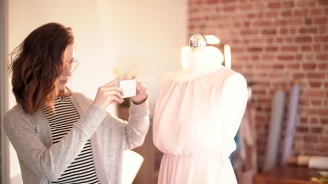 fashion designer taking picture of her project - sarta video stock e b–roll