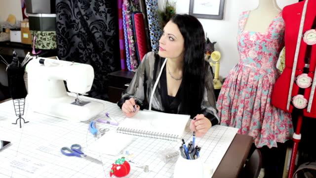 Fashion Designer working in studio video