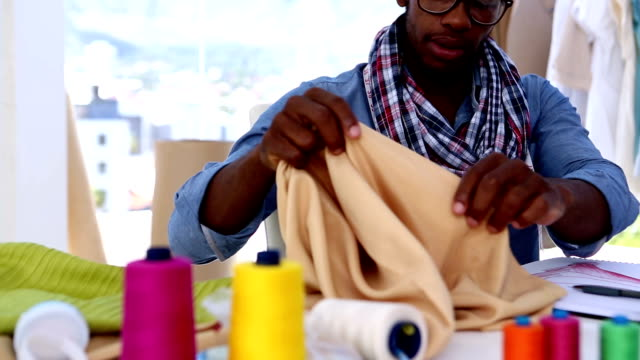Fashion designer working with a fabric video