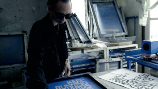 fashion designers screen t-shirt, working at workspace - sarta video stock e b–roll