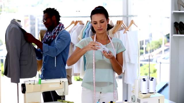 fashion designers working together on a jacket - blazer bildbanksvideor och videomaterial från bakom kulisserna